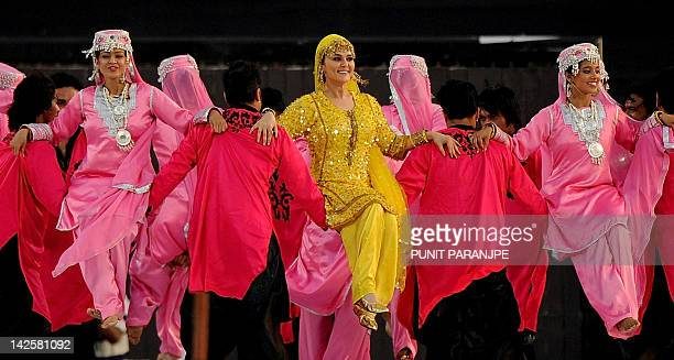 Bollywood actress Preity Zinta performs during a ceremony before the IPL Twenty20 cricket match between Pune Warriors India and Kings XI Punjab at...