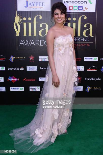 Bollywood actress Priyanka Chopra speaks to the media at the IIFA green carpet event at the 2012 International India Film Academy Awards at the...