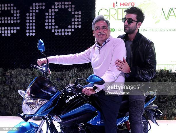 Bollywood actress Ranbir Kapoor and Hero MotoCorp CMD Pawan Munjal poses with a Hero motorcycle at the press preview of the Auto Expo in Greater...