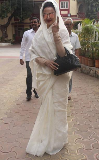 Bollywood actress Rekha casts her vote at Mount Mary Convent High School Bandra on February 21 2017 in Mumbai India Mumbai records 5217% voter...