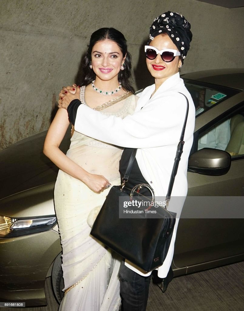 Bollywood actress Rekha embrace Divya Khosla Kumar at the Special Screening of Short Film Bulbul on December 11 2017 in Mumbai India