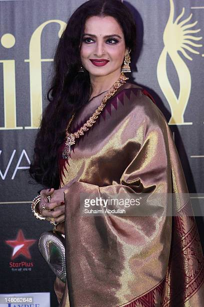 Bollywood actress Rekha poses at the IIFA green carpet event at the 2012 International India Film Academy Awards at the Singapore Indoor Stadium on...