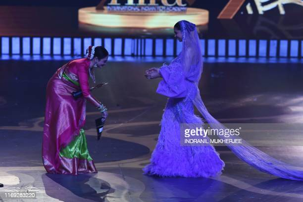 Bollywood actress Rekha presents the Best Actress in Last 20 Years to actress Deepika Padukone during the 20th International Indian Film Academy...