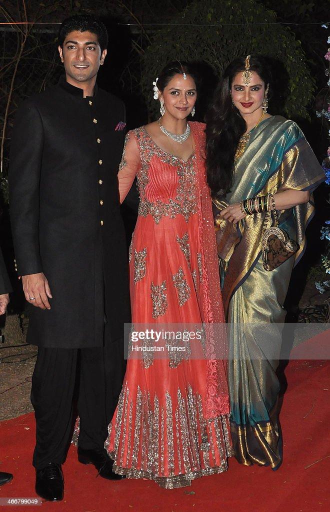 Bollywood actress Rekha with the newly married couple Ahana Deol and Vaibhav Vohra on February 2 2014 in Mumbai India Ahana Deol a budding Odissi...