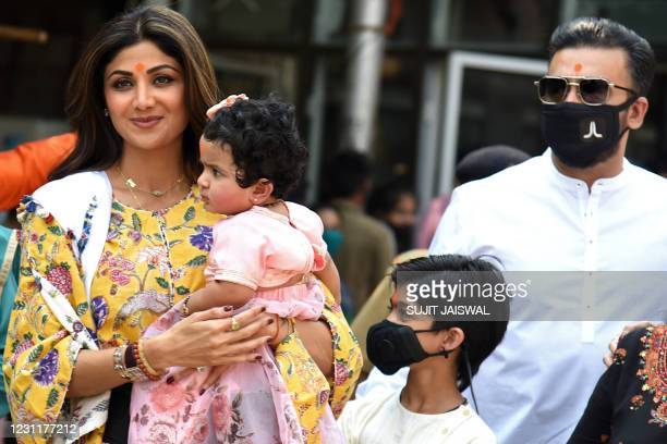 Bollywood actress Shilpa Shetty along with her daughter Samisha , son Viaan and husband Raj Kundra visit the Shree Siddhivinayak Temple in Mumbai on...