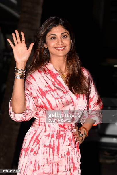 Bollywood actress Shilpa Shetty gestures as she arrived after travelling from Goa, in Mumbai on January 4, 2021.