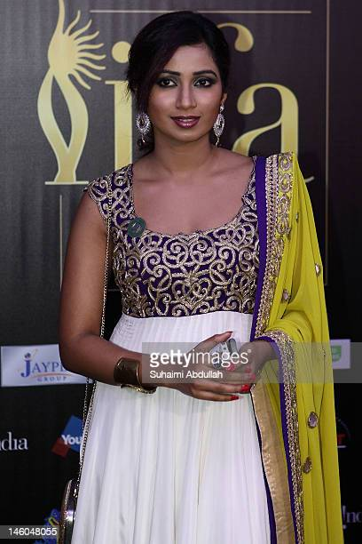 Bollywood actress Shreya Ghosal poses at the IIFA awards green carpet event at the 2012 International India Film Academy Awards at the Singapore...