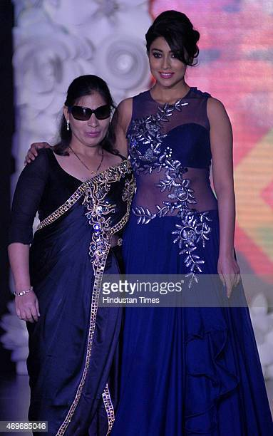 Bollywood actress Shreya Saran walk on ramp with a visually impaired woman during a fashion show organised by the NGO Beti for the support of the...