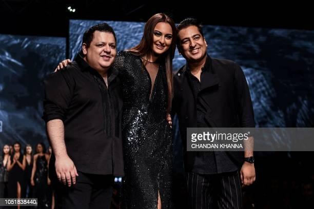 Bollywood actress Sonakshi Sinha presents creations by Indian designer Rohit Gandhi and Rahul Khanna during the Lotus MakeUP India Fashion Week...