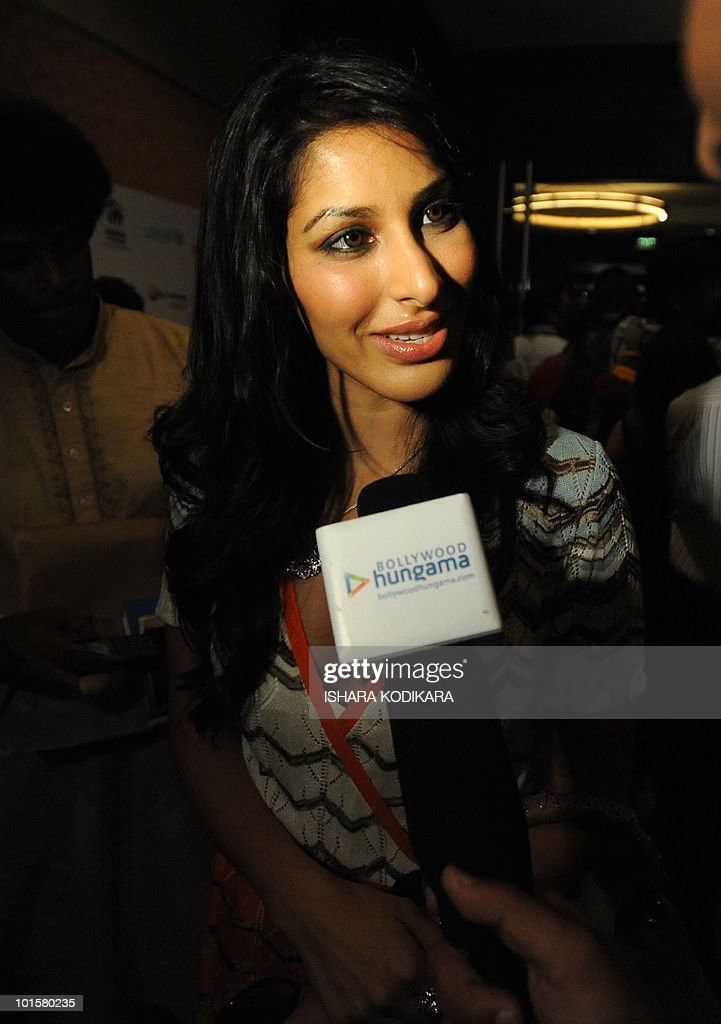 Bollywood actress Sophie Choudhury talks to reporters in Colombo on June 3, 2010. Choudhury is in Sri Lanka to attend the three-day International Indian Film Academy (IIFA) awards that begins in Colombo on Thursday. AFP PHOTO/ Ishara S