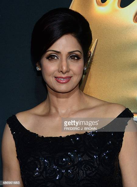 Bollywood actress Sridevi poses on the green carpet at the Raymond James Stadium on the fourth and final day of the 15th International Indian Film...