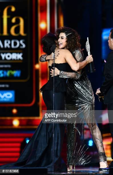Bollywood actress Taapsee Pannu accepts Women of the Year award from Preity Zinta during IIFA award of the 18th International Indian Film Academy...