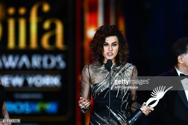 Bollywood actress Taapsee Pannu accepts Women of the Year award during IIFA award of the 18th International Indian Film Academy Festival at the...