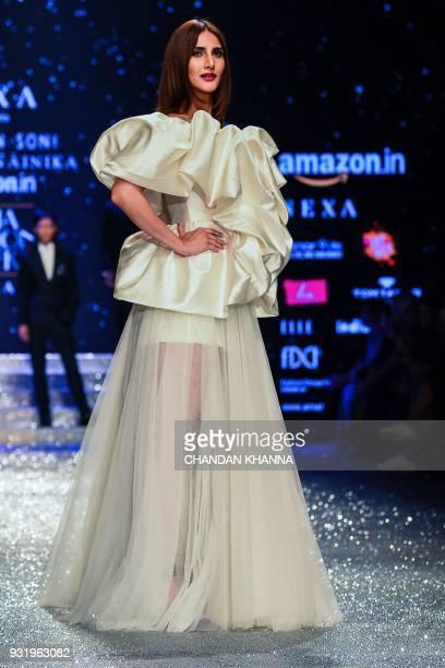 Bollywood actress Vaani Kapoor presents a creation by Indian designer Gauri & Nainika Karan during the Amazon India Fashion Week Autumn Winter 2018...