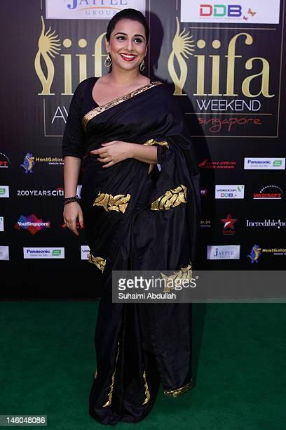 Bollywood actress Vidya Balan poses at the IIFA green carpet event at the 2012 International India Film Academy Awards at the Singapore Indoor...