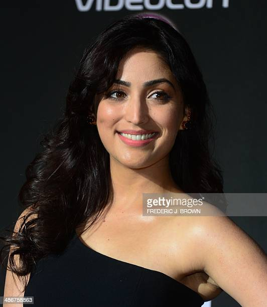 Bollywood actress Yami Gautam poses on the green carpet at the Mid Florida Credit Union Amphitheater ahead of the IIFA Magic of the Movies show on...