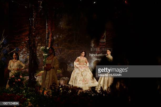 Bollywood actress Yami Gautam presents a creation by Indian designer Reynu Taandon during the India Couture Week 2018 in New Delhi on July 29 2018