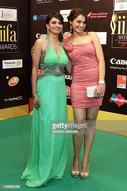 Bollywood actresses Pooja Kumar and Andrea Jeremiah pose on the green carpet during the IIFA Rocks Green Carpet on day two of the 2012 International...