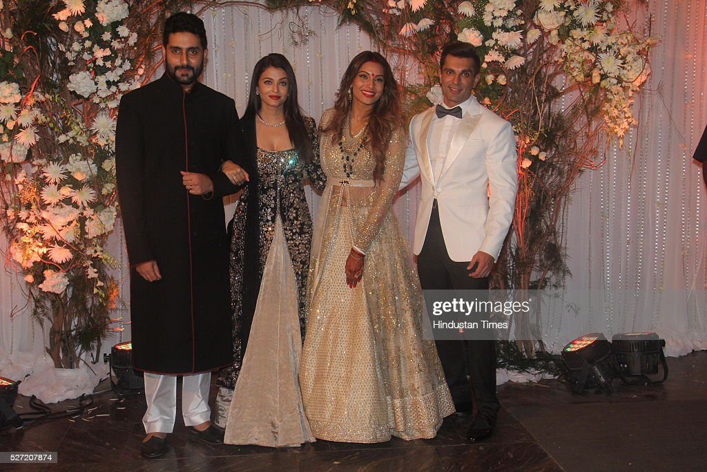 Bollywood couple Abhishek Bachchan and Aishwarya Rai Bachchan pose with newlywed couple Bipasha Basu and Karan Singh at their wedding reception on...