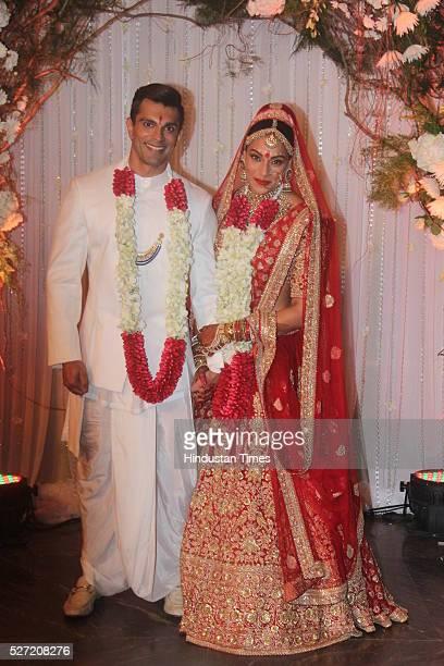 Bollywood couple Bipasha Basu and Karan Singh pose for shutterbugs after their wedding ceremony on April 30 2016 in Mumbai India Bipasha Basu got...
