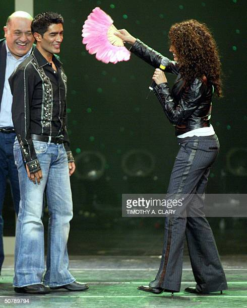 Bollywood Designer of the Year Manish Malhotra is fanned by presenter Kamal Sidhu during the 2004 Bollywood Fashion Awards at the Trump Taj Mahal 30...
