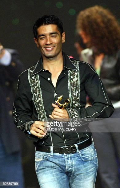 Bollywood Designer of the Year Manish Malhotra walks off with his award during the 2004 Bollywood Fashion Awards at the Trump Taj Mahal 30 April 2004...