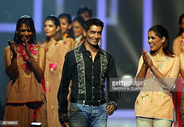 Bollywood Designer of the Year Manish Malhotra with his models during the 2004 Bollywood Fashion Awards at the Trump Taj Mahal 30 April 2004 in...