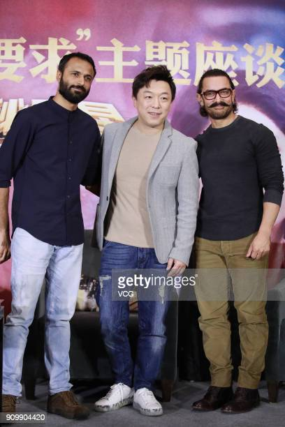 Bollywood director Advait Chandan Chinese actor Huang Bo and Bollywood actor Aamir Khan attend 'Secret Superstar' press conference on January 24 2018...