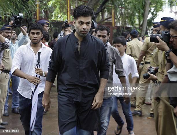 Bollywood director Karan Johar arrives to pay his last respects to Bollywood actor Pran during the cremation at Shivaji Park Crematorium Dadar on...
