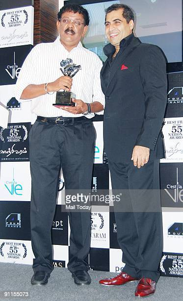Bollywood director Priyadarshan with Shailendra Singh attend a party in honour of the crew of Kanchivaram in Mumbai on September 23 2009 The film...