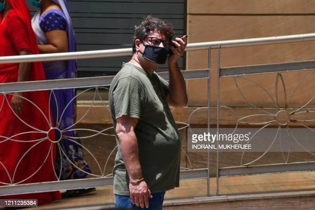 Bollywood director Tigmanshu Dhulia waits for news on actor Irrfan Khan outside the Kokilaben Ambani hospital in Mumbai on April 29 2020 Acclaimed...