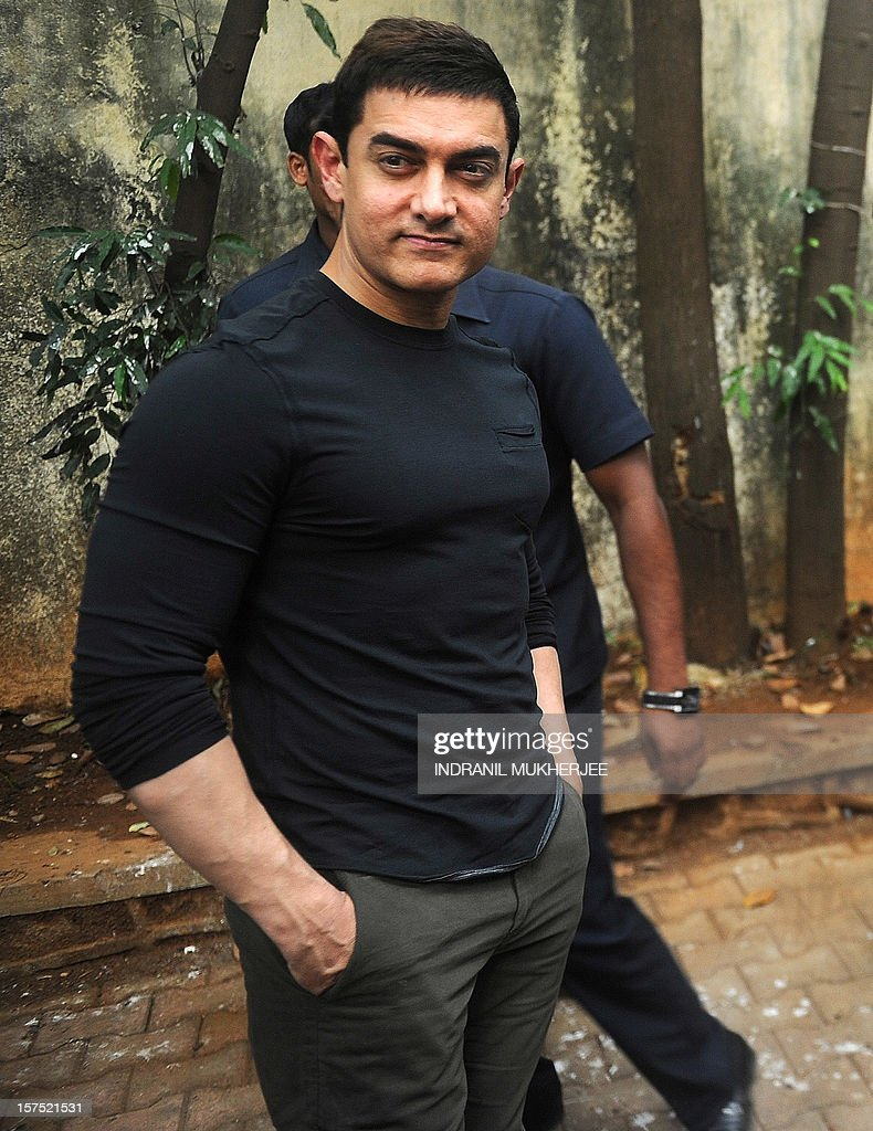 Bollywood film actor Aamir Khan poses after a press conference in Mumbai on December 4, 2012. Khan, dubbed as Indian cinema's Mr Perfectionist returned to the big screen in his first commercial film release for three years, taking up the role of a mustachioed police inspector in a Mumbai crime thriller 'Talaash' (Search). Earlier this year Khan launched a 13-episode Sunday morning television show that won plaudits for tackling some of India's darkest social problems, drawing comparisons between him and US chat show host Oprah Winfrey.