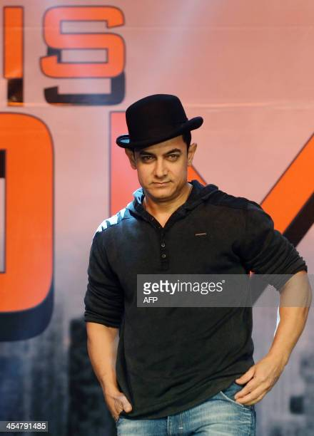 Bollywood film actor Aamir Khan poses before a news conference for his upcoming film 'Dhoom 3' in Mumbai on December 10 2013 The Hindi action...