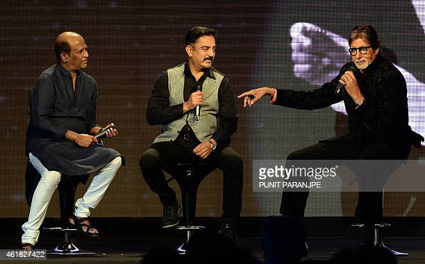 Bollywood film actor Amitabh Bachchan speaks as actors Kamal Haasan and Rajinikanth look on during the music launch of Bachchan's new film...