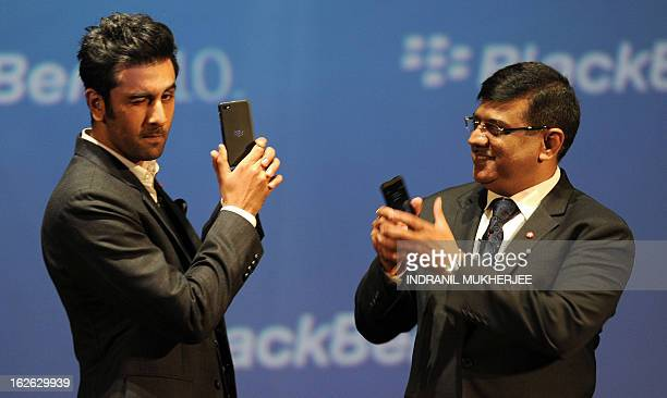Bollywood film actor and BlackBerry brand ambassador Ranbir Kapoor poses with the BlackBerry Z10 as Managing Director for BlackBerry India Sunil Dutt...
