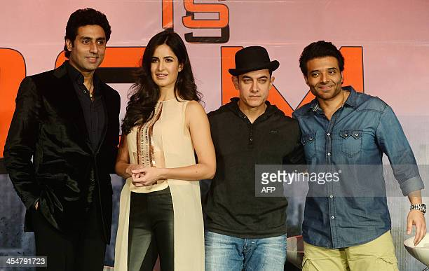 Bollywood film actors Aamir Khan Katrina Kaif Abhishek Bachchan and Uday Chopra pose after a news conference for their upcoming film 'Dhoom 3' in...