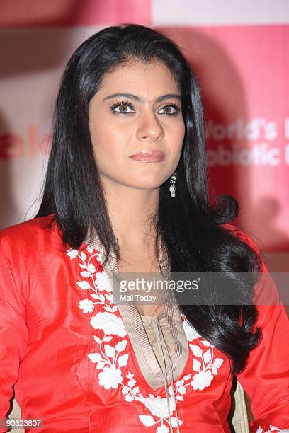 Bollywood film actress Kajol poses at a press conference to unveil the Japanese probiotic drink Yakult for which she is brand ambassador in Mumbai on...