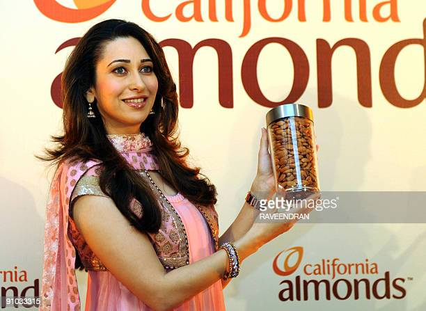 Bollywood film actress Karisma Kapoor hold California almonds during their launch in New Delhi on September 23 2009 The Almond Board of California...