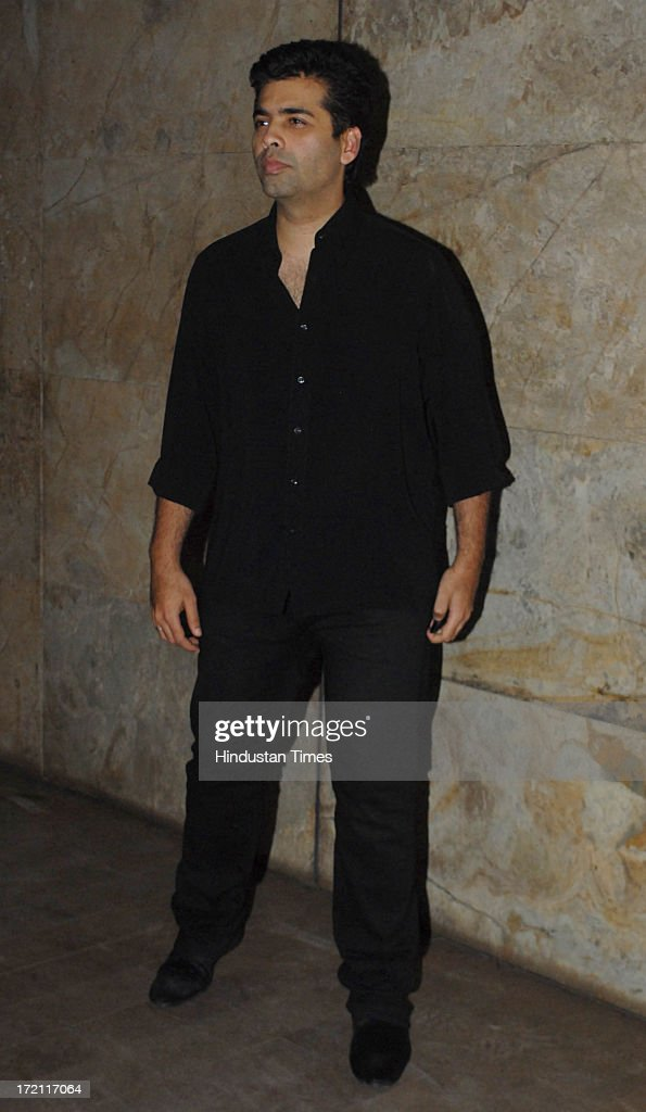 Bollywood film director and producer Karan Johar during the special screening of film Lootera at Light Box Santracruz on JUNE 30 2013 in Mumbai India.