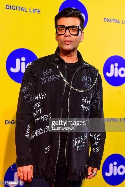 Bollywood film director Karan Johar poses for photographs as he attends the Jio MAMI' 21st Mumbai Film Festival in Mumbai on October 13 2019