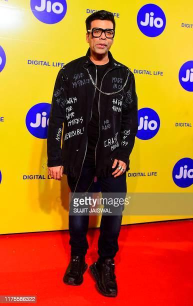 Bollywood film director Karan Johar poses for photographs as he attends the Jio MAMI' 21st Mumbai Film Festival in Mumbai on October 13, 2019.