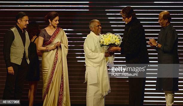 Bollywood film star Amitabh Bachchan felicitates music director Ilaiyaraaja as film actors Sridevi Rajinikanth and Kamal Haasan look on during the...