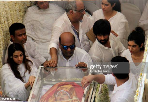 Bollywood filmmaker and husband Boney Kapoor with daughters Jhanvi and Khushi during funeral of the late Bollywood actress Sridevi Kapoor passes...