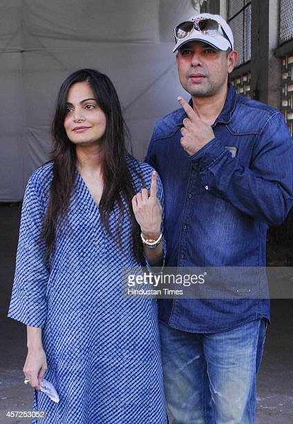 Bollywood filmmaker Atul Agnihotri with his wife Alvira Khan showing inked finger after casting votes for Maharashtra Assembly Elections 2014 polls...