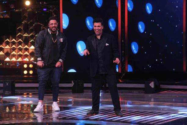 Bollywood filmmaker Karan Johar and singer Badshah during the promotion of film Noor and Nach Baliye integration on the sets of Star Plus singing...