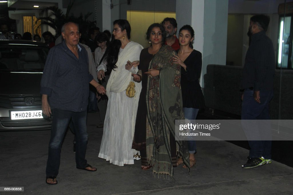 Bollywood filmmaker Mahesh Bhatt actors Vidya Balan Rekha and Alia Bhatt during the special screening of film Begum Jaan at Sunny Super Sound Juhu on.