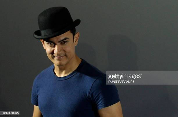 Bollywood fiolm actor Aamir Khan attends a news conference to announce the release of the first trailer of his new film 'Dhoom 3' in Mumbai on...
