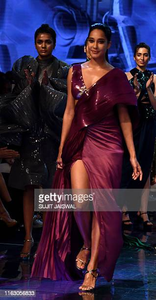 Bollywood Lisa Haydon presents a creation by designer Amit Aggrawal during a fashion show at Lakme Fashion Week Winter Festive 2019 in Mumbai on...