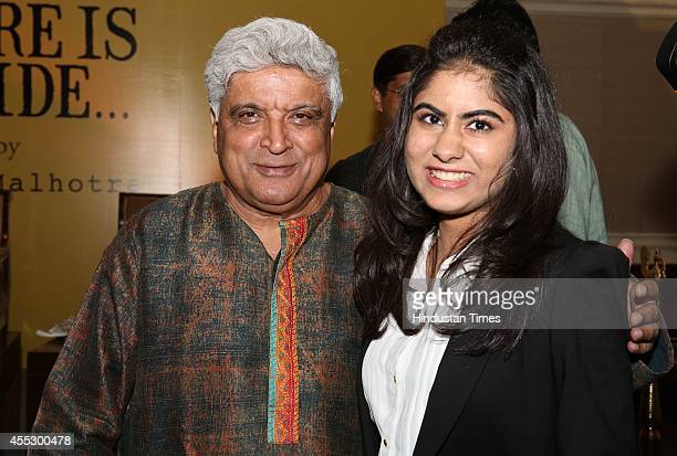 Bollywood lyricist Javed Akhtar and author Simar Malhotra during the launch of her novel There is a Tide at The Oberoi hotel on September 9 2014 in...