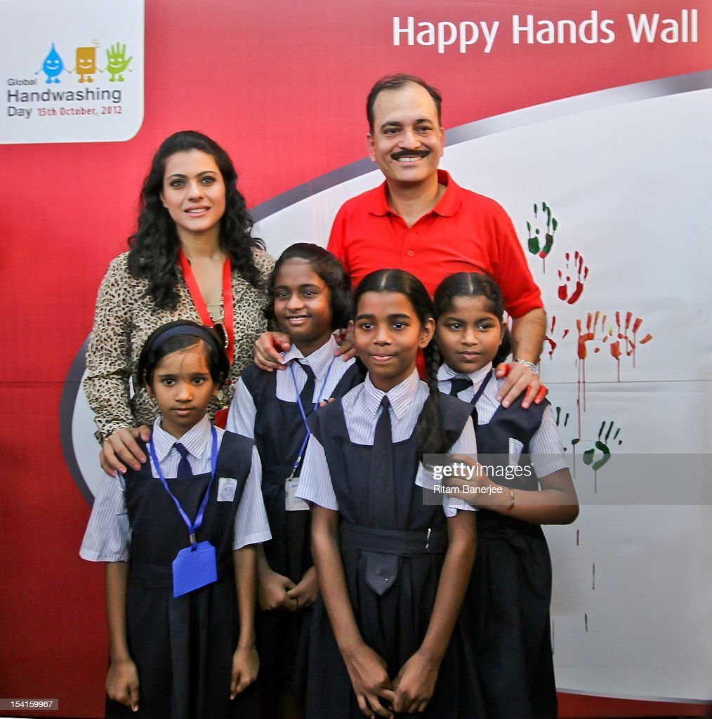 Bollywood movie actress Kajol and with Nitin Paranjpe pose with school children on Global handwashing Day at Worli Seaface Mumbai Municipal...